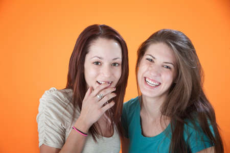 Two girlfriends sharing a joke and laughing Stock Photo - 8924448
