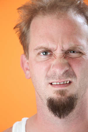 yuck: Lazy Caucasian male with goatee expressing his disgust