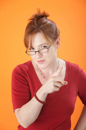 Caucasian lady with glasses pointing her finger photo