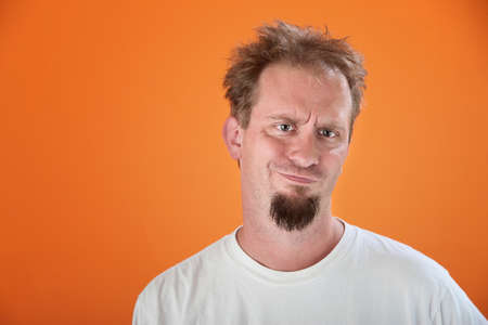 whatever: Caucasian man with a goatee is unimpressed Stock Photo