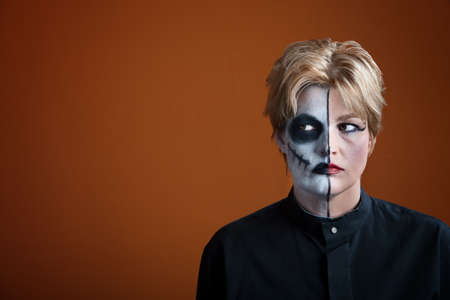 janus: Woman wearing creepy makeup for Dia de los Muertos Stock Photo