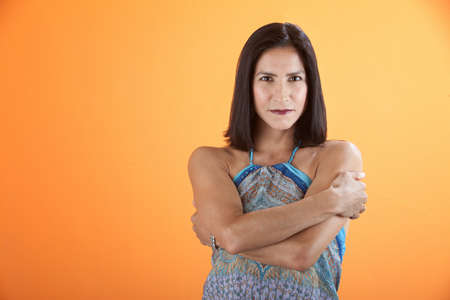 Beautiful and fit Hispanic woman with folded arms photo