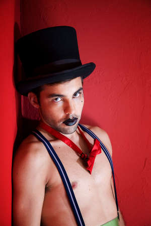 Young man in top hat and suspenders Stock Photo - 8924452