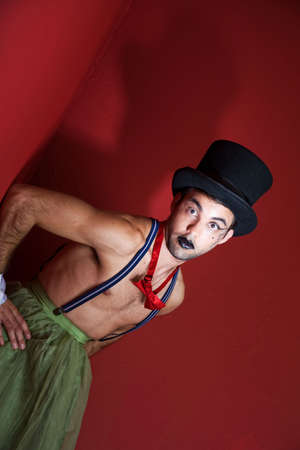outrageous: Outrageous circus performer in top hat and face makeup