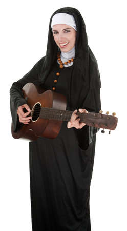 Nun in a happy mood playing a guitar  photo