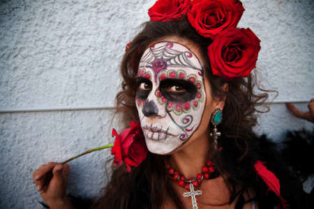 Woman wearing makeup and beautiful red roses for All Souls Day Standard-Bild