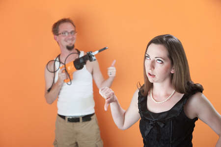 wifebeater: Young Caucasian woman unhappy with a confident handyman