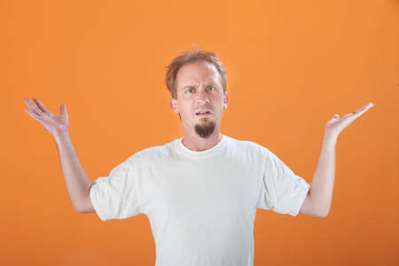 laidoff: Frustrated Caucasian male with hands in the air