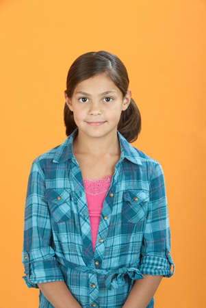 behave: Obedient Mexican American girl on an orange background