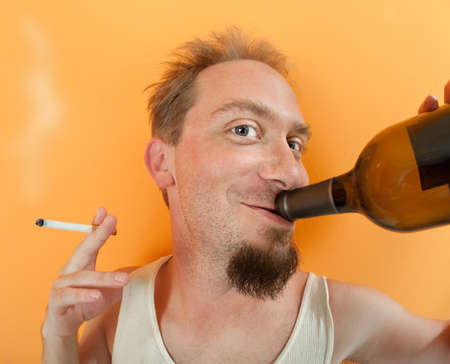 wifebeater: Happy Caucasian man holding a bottle and a cigarette