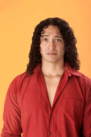 whimper: Handsome worried muscular Native American on an orange background