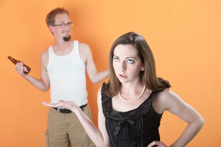 loser: Woman unhappy with man holding beer bottle
