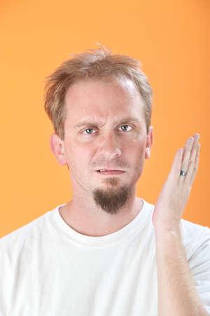 duh: Caucasian man gestures a slap in the face Stock Photo