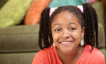 beautiful preteen girl: Happy African American girl in her room