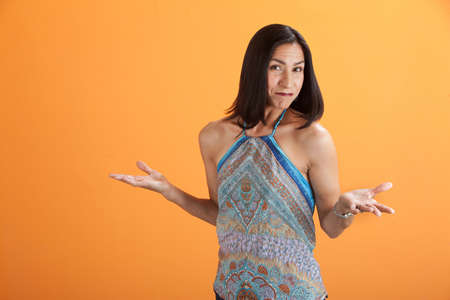 Beautiful Latina on orange background with her hands open photo