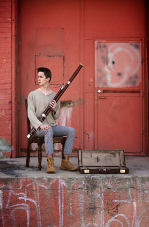 Young Caucasian street Bassoon musician Stock Photo - 9136919
