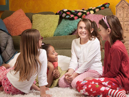 preteen girl: Four excited little girls together for a sleepover party Stock Photo