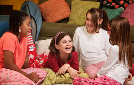Group of happy young girls at a sleepover photo