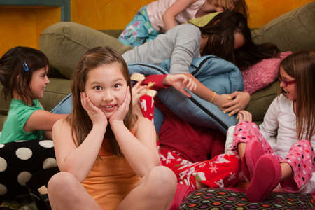 chaos: Girl overwhelmed with silly friends at a sleepover