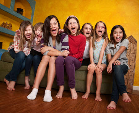 sleepover: Group of happy barefoot girlfriends scream out