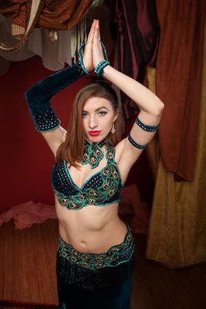 velvet dress: Beautiful belly dancer with velvet dress in Namaskar pose Stock Photo