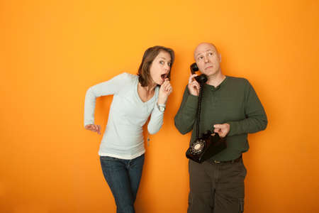 Surprised woman with man on telephone conversation photo