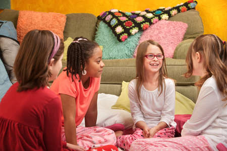 Group of little young girls chat at a sleepover photo
