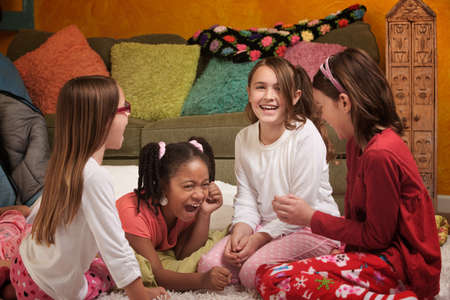 Little Girls at a sleepover laugh together photo
