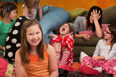 Happy little girl with friends at a sleepover photo