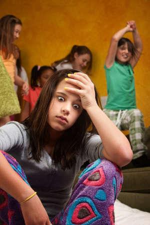 Overwhelmed and tired teen girl babysitting wild kids