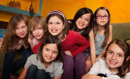 preteen girls: Group of seven happy little girls smiling