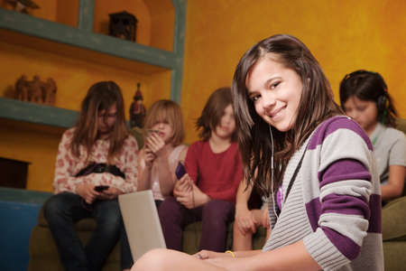 involve: Smiling girl with friends listening to using laptop computer or game console