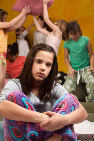 sleepover: Overwhelmed babysitter with wild little girls at a sleepover Stock Photo