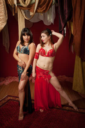 Gorgeous Latina and Caucasian Belly Dancers with beautiful legs photo