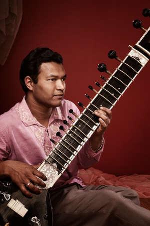 Young Indian man playing Sitar Stock Photo - 9610978