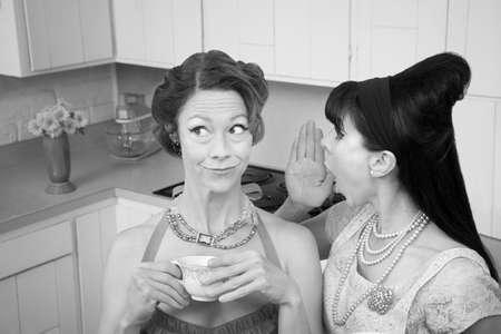 Retro styled woman whispers secret into friend's ear