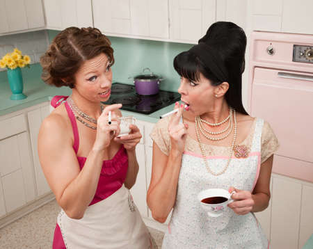 Gossping women smoking and drinking tea in a retro-style kitchen  photo
