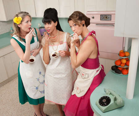 oven tray: Three beautiful retro-styled women enjoy cup of coffee with cigarette