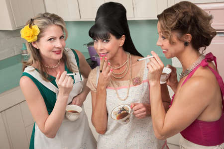 Three middle-aged woman smoke in a retro-style tea party photo