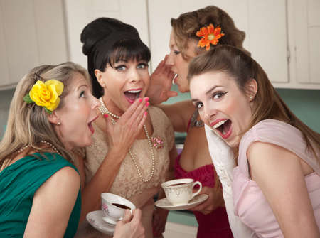bouffant: Group of four retro fashion housewives tell secrets in the kitchen