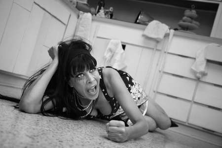 Weeping woman on the floor throws a temper tantrum on floor photo