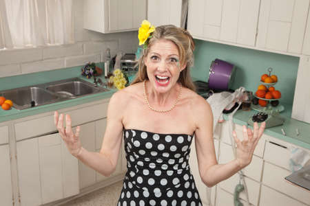 Angry Caucasian woman screams in her kitchen photo