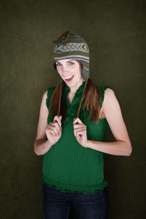 showoff: Happy Young Woman on green background with Knit Cap