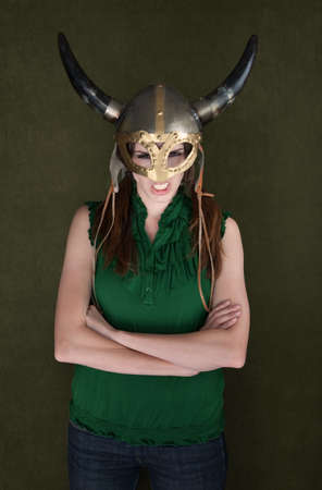Angry woman with folded arms in Viking helmet