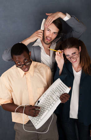 Geek with keyboard, salesman combing his hair and a nerd scratching her head photo