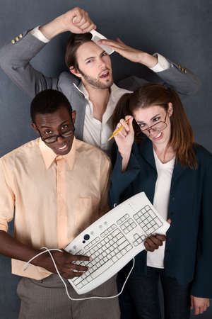 huh: Geeks with keyboard, salesman comb and pencil making faces