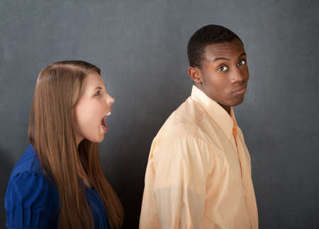 enraged: Handsome Black male ignores an enraged Caucasian female Stock Photo