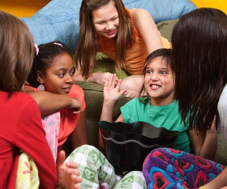 asian bowl: Little girl sharing a joke with her friends