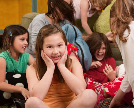 preteens girl: Smiling little girl at a sleepover with her friends