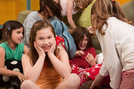 horseplay: Little girl smiles at a sleepover with friends  Stock Photo